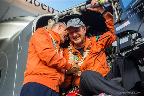 Jubilant Swiss explorers Andre Borschberg (right) and Bertrand Piccard after landing the Solar Impulse in Kalaeloa, Hawaii after five days and nights of non-stop flight. Image: Solarimpulse.com